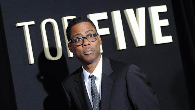 "FILE - In this Dec. 3, 2014 file photo, actor Chris Rock attends the premiere of ""Top Five"" at the Ziegfeld Theatre in New York. While out promoting the film this week, Rock noted: ""My movie's very Korean-friendly. There are no jokes about North Korea in 'Top Five.' If you're Korean, go out and see 'Top Five.' You will enjoy it."" (Photo by Evan Agostini/Invision/AP, File)"