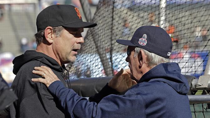 Detroit Tigers manager Jim Leyland, left, talks to San Francisco Giants manager Bruce Bochy before Game 1 of baseball's World Series Wednesday, Oct. 24, 2012, in San Francisco. (AP Photo/David J. Phillip)