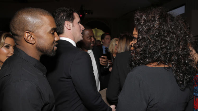 Kanye West, left, and Oprah Winfrey attend THR's celebration of power 100 women in entertainment breakfast on Wednesday, Dec. 11, 2013 in Beverly Hills, Calif. (Photo by Todd Williamson/Invision for The Hollywood Reporter/AP Images)