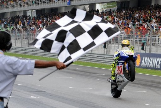 Valentino Rossi of Fiat Yamaha celebrates defending his seventh Moto GP title at the Sepang racing circuit