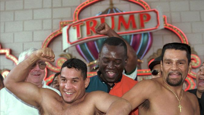 """FILE - In this June 21, 1996 file photo, after a ceremonial weigh-in, Panamanian Roberto Duran, right, reaches for the stomach of  boxing champ Hector """"Macho"""" Camacho, left, who tries to elbow Duran's hand away at the Trump Taj Mahal Casino Resort in Atlantic City, N.J. Camacho, a boxer known for skill and flamboyance in the ring, as well as for a messy personal life and run-ins with the police, has died, Saturday, Nov. 24, 2012, after being taken off life support. He was 50. (AP Photo/Charles Rex Arbogast, File)"""
