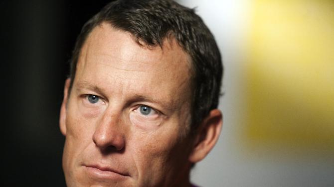 FILE - In this Feb. 15, 2011 file photo, Lance Armstrong pauses during an interview in Austin, Texas. Local and international news crews are staking out positions in front of Armstrong's lush, Spanish-style villa ahead of the cyclist's interview with Oprah Winfrey later Monday, Jan. 14, 2013.  (AP Photo/Thao Nguyen, File)