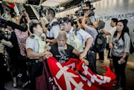 A protester (C) is blocked by policemen as he and others try to force their way into the building where the Japanese consulate is located, in Hong Kong, on September 12. The demonstrators were protesting against the Japanese government's recent announcement it would purchase a group of disputed islands in the East China Sea