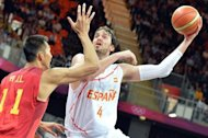 Spanish forward Pau Gasol (R) shoots in front of Chinese centre Yi Jianlian during the Men&#39;s Preliminary Round Group B match Spain vs China at the London 2012 Olympic Games in London. Los Angeles Lakers NBA star Pau Gasol scored 21 points and grabbed 11 rebounds, sparking 2008 Olympic silver medallist Spain over China 97-81 on Sunday in a Group B round-robin Olympic basketball opener
