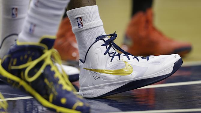 "Indiana Pacers' Roy Hibbert displays a ""B Strong"" logo on his shoe during the first half of Game 1 in the first round of the NBA basketball playoffs against the Atlanta Hawks, Sunday, April 21, 2013, in Indianapolis. (AP Photo/Darron Cummings)"
