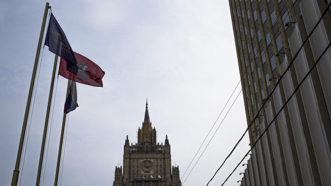 """The Russian Foreign Ministry headquarters seen at the background in Moscow on Thursday, Oct. 4, 2012.  US prosecutors allege that naturalized U.S. citizen  Alexander Fishenko and six others """"engaged in a surreptitious and systematic conspiracy"""" to obtain highly regulated technology from U.S. makers and sold them to Russian authorities. Fishenko and six others charged in the alleged scheme are expected to appear Thursday morning in U.S. Houston federal court.  (AP Photo/Alexander Zemlianichenko)"""
