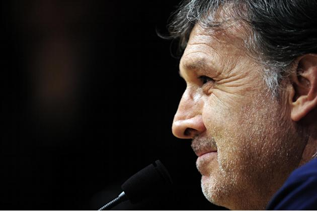 Barcelona's coach Gerardo Tata Martino from Argentina attends a press conference at the Camp Nou in Barcelona, Spain, Tuesday, Nov. 5, 2013.  FC Barcelona will play against AC Milan in a group H Champ