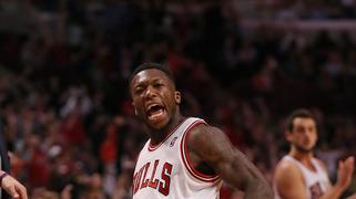 Bulls stop Knicks streak at 13 with 118-111 OT win