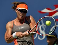 Samantha Stosur of Australia returns against Varvara Lepchenko of the US during their 2012 US Open women's singles match at the USTA Billie Jean King National Tennis Center in New York. Stosur reached the fourth round with a 7-6 (7/5), 6-2 victory