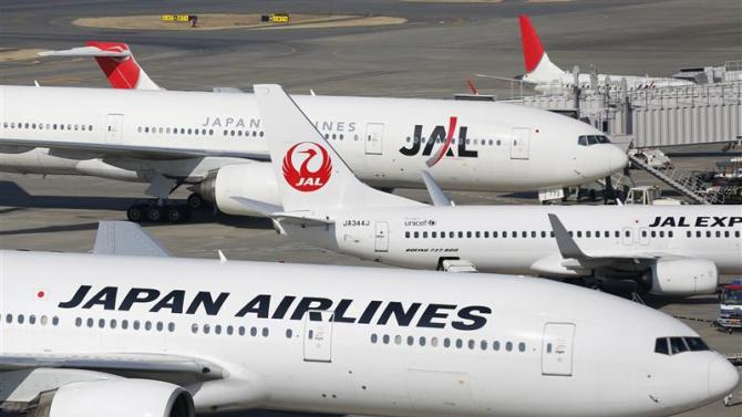 Japan Airlines aircrafts are parked on the tarmac at Haneda Airport in Tokyo