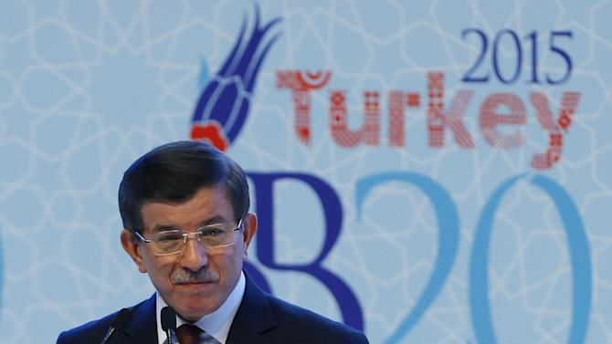 Turkey's Prime Minister Ahmet Davutoglu addresses the audience during a conference in Ankara