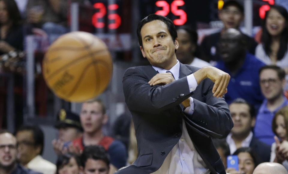 After a ball bounced out of bounds, Miami Heat coach Erik Spoelstra throws to a game official during the first half of a NBA basketball game in Miami, Friday, March 8, 2013 against the Philadelphia 76ers.. (AP Photo/J Pat Carter)