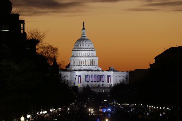 The sun rises over Capitol Hill looking down Pennsylvania Avenue in Washington, Monday, Jan. 21, 2013, as Washington prepares for the 57th Presidential Inaugural and the ceremonial swearing-in of President Barack Obama's second term. (AP Photo/Alex Brandon)