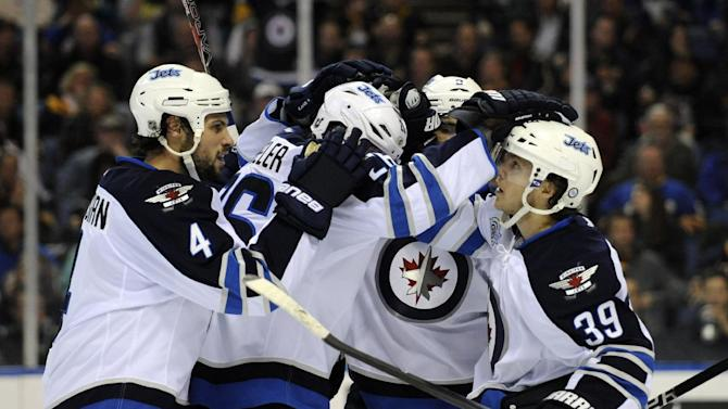 Winnipeg Jets' Blake Wheeler, center, celebrates his goal with teammates against the Buffalo Sabres, during the second period of an NHL hockey game in Buffalo, N.Y., Saturday, Jan. 7, 2012. The Jets won, 2-1. (AP Photo/Gary Wiepert)