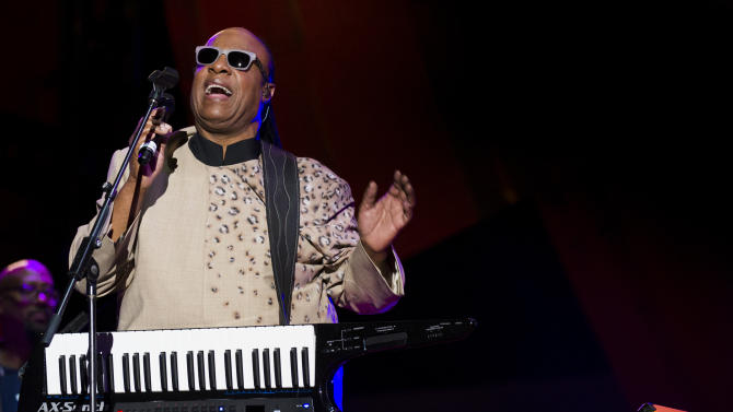 Stevie Wonder performs at the Global Citizen Festival in Central Park on Saturday, Sept. 28, 2013 in New York. Stevie Wonder gave and electrifying performance at New York's Central Park in front of thousands of fans and several world leaders Saturday, singing his hits and calling for an end to poverty worldwide at the Global Citizen Festival. (AP Photo/unite4:good, Charles Sykes/Invision)