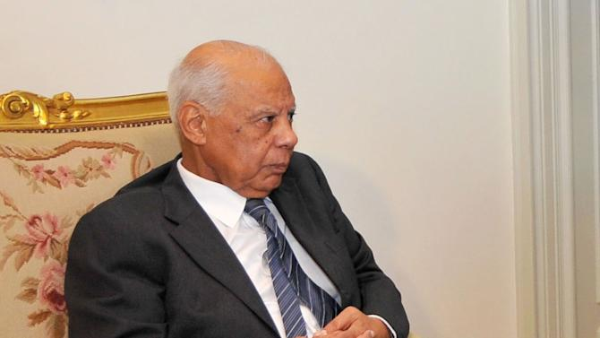 In this image released by the Egyptian Presidency, Hazem el-Beblawi meets with interim President Adly Mansour, unseen, in Cairo, Egypt, Tuesday, July 9, 2013. The spokesman of Egypt's interim president says a prominent economist, Hazem el-Beblawi, has been named prime minister and pro-democracy leader Mohamed ElBaradei as a vice-president. Ahmed el-Musalamani made the announcements Tuesday after days of political stalemate over the prime minister post. El-Beblawi, who is in his 70s, served as finance minister in one of the first cabinets formed after the 2011 uprising forced Hosni Mubarak from power and the military stepped in to rule. (AP Photo/Egyptian Presidency)