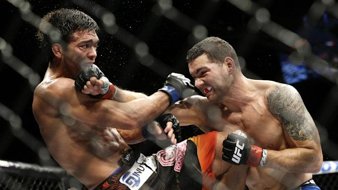 Chris Weidman, right, hits Lyoto Machida during their mixed martial arts middleweight title bout at UFC 175 Saturday, July 5, 2014, in Las Vegas. (AP Photo/John Locher)