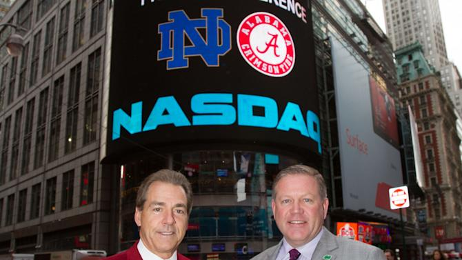 In this photo provided by NASDAQ, University of Alabama head football coach Nick Saban, left, poses with Notre Dame head football coach Brian Kelly outside of the NASDAQ MarketSite in New York, Wednesday, Dec. 5, 2012. (AP Photo/NASDAQ, Zef Nikolla)