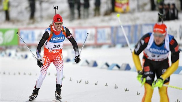 Jean Philippe Leguellec (L) of Canada crosses the finish line of the men's 10km individual biathlon IBU World Cup in Ostersund, Sweden