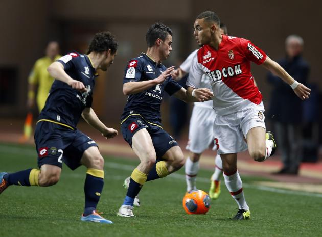 AS Monaco's Kurzawa challenges Sochaux's Corchia and Faussurier during their French Ligue 1 soccer match in Monaco