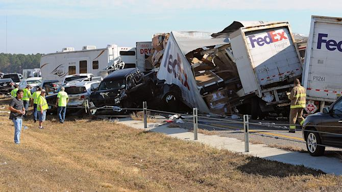 Cars and Trucks are piled on Interstate 10 in Southeast Texas Thursday Nov. 22, 2012.  The Texas Department of Public Safety says at least 35 people have been injured in a more than 50-vehicle pileup.    (AP Photo/The Beaumont Enterprise, Guiseppe Barranco) Mandatory Credit