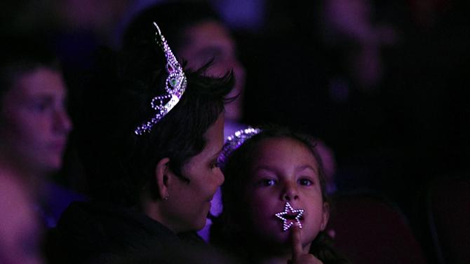 "Halle Berry, left, and her daughter Nahla Aubry attends The Hub TV Network's ""My Little Pony Friendship is Magic"" Coronation Concert at the Brentwood Theatre on Saturday, Feb. 9, 2013, in Los Angeles in support of Children's Hospital LA. (Photo by Matt Sayles/Invision for The Hub/AP Images)"