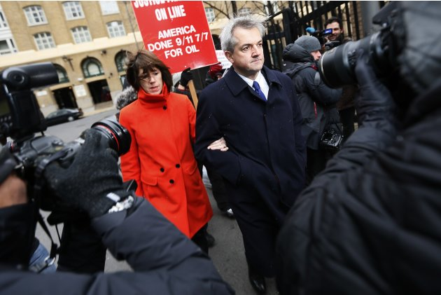Chris Huhne, Britain's former energy secretary, is accompanied by his partner Carina Trimingham, as he arrives to be sentenced at Southwark Crown Court in London