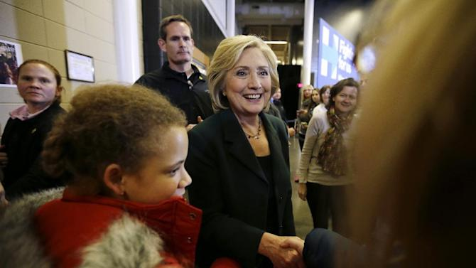 FILE - In this Nov. 22, 2015 file photo, Democratic presidential candidate Hillary Rodham Clinton greets supporters during a town hall meeting in Clinton, Iowa. As secretary of state, Clinton opened her office to dozens of influential Democratic party fundraisers, former Clinton administration and campaign loyalists and corporate donors to her family's global charity, according to State Department calendars obtained by The Associated Press. (AP Photo/Charlie Neibergall, File)