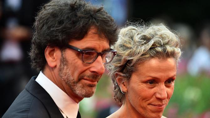 "Actress Frances McDormand arrives with husband Joel Coen to receive the ""Persol tribute to visionary talent award"" during the 71st Venice Film Festival on September 1st, 2014 in Italy"