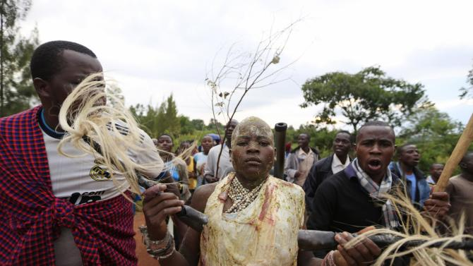 Bukusu villagers escort a youth from his uncle's home as part of a circumcision ritual in Kenya's western region of Bungoma