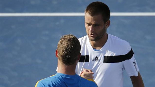 Mikhail Youzhny of Russia (R) is congratulated by Lleyton Hewitt of Australia after their match (Reuters)