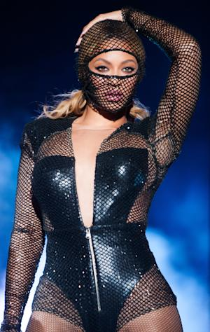 Beyonce performs during the On The Run tour at the Georgia Dome on Tuesday, July 15, 2014 in Atlanta, Georgia. (Photo by Rob Hoffman/Invision for Parkwood Entertainment/AP Images)