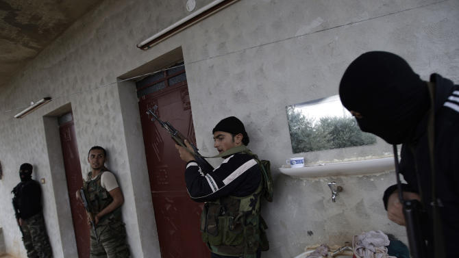 In this Monday, Dec. 17, 2012 photo, Syrian rebels attend a training session in Maaret Ikhwan, near Idlib, Syria. The training is part of an attempt to transform the rag-tag rebel groups into a disciplined fighting force. (AP Photo/Muhammed Muheisen)