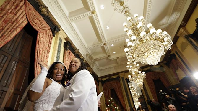 Darcia Anthony, left, and Danielle Williams react after participating in a wedding ceremony at City Hall in Baltimore, Tuesday, Jan. 1, 2013. Same-sex couples in Maryland are now legally permitted to marry under a new law that went into effect after midnight on Tuesday. Maryland is the first state south of the Mason-Dixon Line to approve same-sex marriage. (AP Photo/Patrick Semansky)