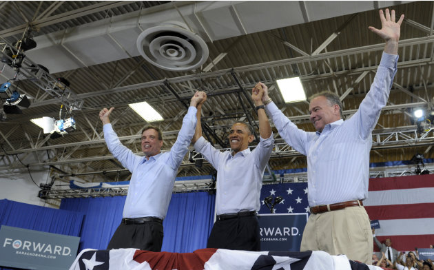 President Barack Obama, accompanied by Sen. Mark Warner, D-Va., left, and Virginia Democratic candidate, former Virginia Gov. Tim Kaine, right, take part in a campaign event at Green Run High School i