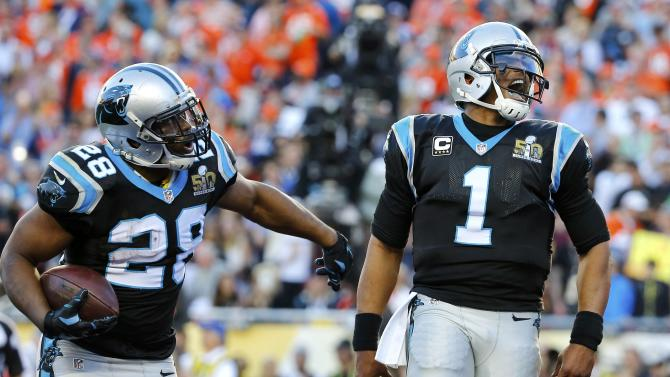 Carolina Panthers' quarterback Newton and Stewart celebrate a touchdown against the Denver Broncos in the second quarter of the NFL's Super Bowl 50 football game in Santa Clara