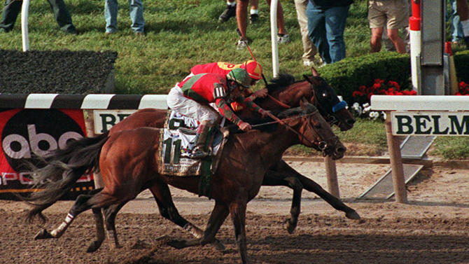 FILE - In this June 6, 1998, file photo, Victory Gallop and jockey Gary Stevens (11) edge out Real Quiet and jockey Kent Desormeaux as they cross the finish line to win the Belmont Stakes horse race at Belmont Park in Elmont, N.Y. Desormeaux was criticized for making his move too early, and by the time Real Quiet was a furlong from the finish, Victory Gallop was making its charge at the wire to eventually take the win. As I'll Have Another prepares to attempt to win the Belmont Stakes in his quest to become the 12th Triple Crown champion and first in 34 years on Saturday, June 9, 2012, The Associated Press takes a look at some of the 19 horses who won the Kentucky Derby and the Preakness, but came up short in the final leg of the Triple Crown, and how the race unfolded. (AP Photo/Bill Kostroun, File)