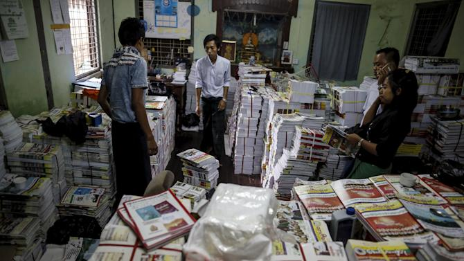 Staff members pack copies of the Thargi Nwe Thway journal promoting nationalism published by Ma Ba Tha to be delivered around the country at a warehouse at Ma Ba Tha's head office in Yangon