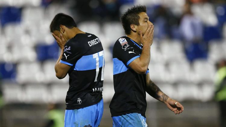 Ramos and Llanos of Chile's Universidad Catolica react after conceding a goal during their Copa Sudamericana match against Uruguay's River Plate in Santiago