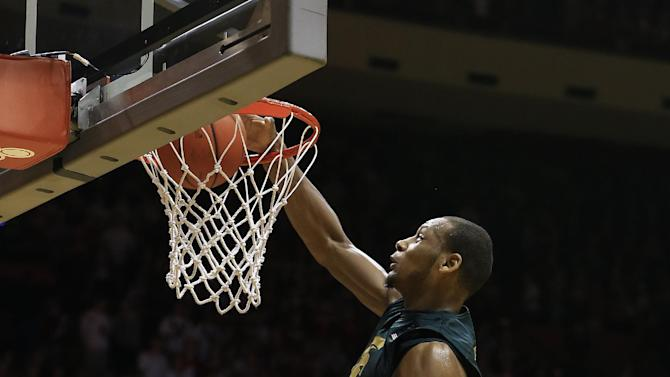 Michigan State's Adreian Payne (5) dunks against Indiana's Christian Watford during the first half of an NCAA college basketball game on Sunday, Jan. 27, 2013, in Bloomington, Ind. (AP Photo/Darron Cummings)