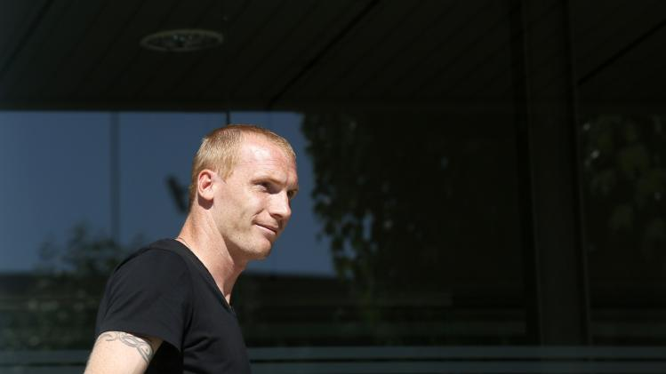 French soccer player Jeremy Mathieu arrives at FC Barcelona's offices in Barcelona