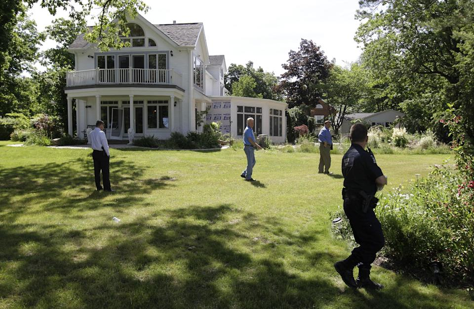 Law enforcement officers search the at home of Dr. Timothy Jorden in Hamburg, N.Y., Thursday, June 14, 2012.  Jorden is sought in connection with the hospital shooting death of his ex-girlfriend at Erie County Medical Center in Buffalo, N.Y. on Wednesday.  (AP Photo/David Duprey)