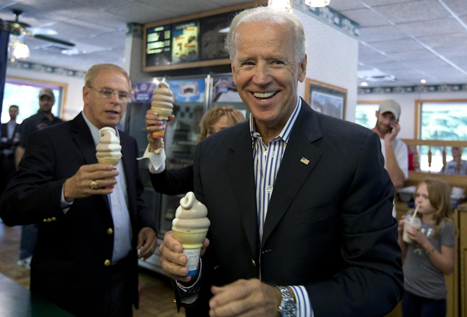 Vice President Joe Biden stops for an ice cream cone at a Dairy Queen, Saturday, Sept. 8, 2012, in Nelsonville, Ohio, with former Ohio Gov. Ted Strickland, right.  (AP Photo/Carolyn Kaster)