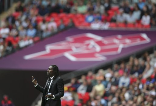 Senegal head coach Abdoukarime Diouf watches before their men's preliminary first round Group A soccer match against Uruguay at the London 2012 Olympic Games in the Wembley Stadium in London