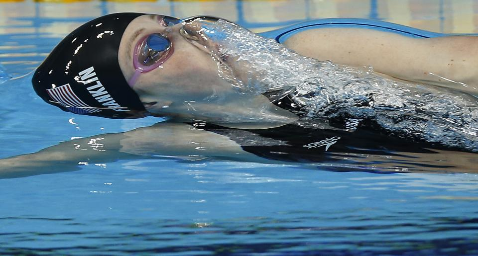 United States' Missy Franklin swims during her women's 100-meter backstroke final at the Aquatics Centre in the Olympic Park during the 2012 Summer Olympics in London, Monday, July 30, 2012. (AP Photo/Daniel Ochoa De Olza)