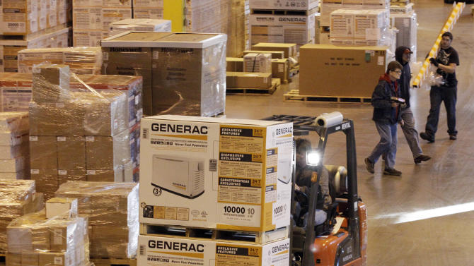 In this Friday, Nov. 16, 2012, photo, employees work at a shipping area of Generac Power Systems, Inc., in Whitewater, Wis., Friday, Nov. 16, 2012. Orders to U.S. factories rose modestly in October, helped by a big gain in demand for equipment that reflects business investment plans. Factory orders edged up 0.8 percent in October, the Commerce Department said Wednesday. That compared to September when orders had jumped 4.5 percent. (AP Photo/Nam Y. Huh)