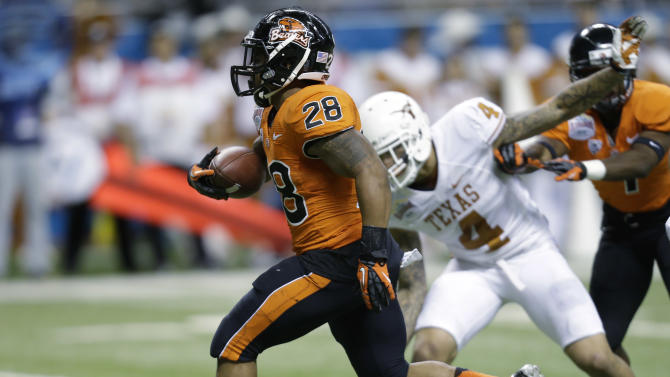 Oregon State's Terron Ward (28) runs past Texas defender Kenny Vaccaro (4) to score a touchdown in the second quarter of the Alamo Bowl NCAA football game, Saturday, Dec. 29, 2012, in San Antonio.  (AP Photo/Eric Gay)