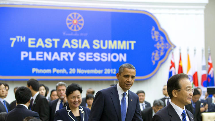 U.S. President Barack Obama, center, arrives for the East Asian Summit Plenary Session at the Peace Palace in Phnom Penh, Cambodia, Tuesday, Nov. 20,  2012. Walking in front of President Obama is Chinese Premier Wen Jiabao.  (AP Photo/Carolyn Kaster)