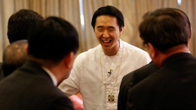 """FILE - In this Sept. 20, 2009 file photo, the Rev. Hyung-jin Moon, the youngest son of the Rev. Sun Myung Moon, is welcomed by followers during a service at a Unification Church in Seoul, South Korea. Moon's U.S.-born youngest son, Hyung-jin Moon, was named the church's top religious director in April 2008. Other children run the church's businesses and charitable activities. Hyung-jin Moon told The Associated Press in February 2010 that his father's offspring do not see themselves as his successors. """"Our role is not inheriting that messianic role,"""" he said. """"Our role is more of the apostles ... where we become the bridge between understanding what kind of lives (our) two parents have lived."""" (AP Photo/Ahn Young-joon, File)"""