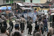 Indonesian police clash with striking workers of US gold and copper mining giant company Freeport McMoran in Timika in Indonesia's Papua province in October 2011. A three-month strike over wages and work conditions last year turned violent, with at least eight people killed